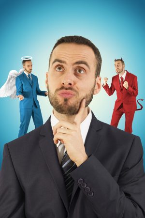 Young businessman with angel and devil on his shoulders.